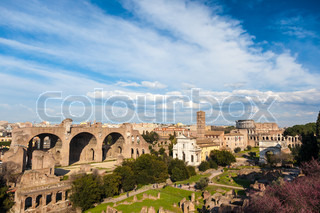 Famous italian landmark: the ancient Roman Forum (Foro Romano) with the Colosseo in background