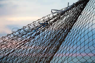 Fishing net silhouette above morning sky background