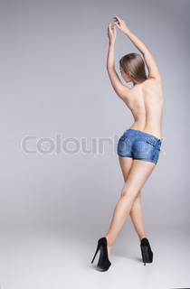 Rear view of sexy woman in jean shorts