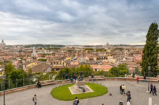 ROME - NOVEMBER 2, 2012: Tourists enjoy city streets. More than 15 million people visit the city every year.