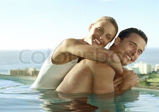 Young couple embracing in pool