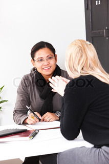 Two female work colleagues brainstorming a project