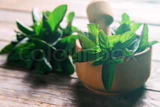 Mint in mortar with pestle