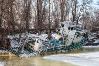 an old abandoned ship in the ice