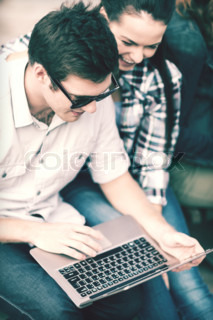 students or teenagers with laptop computer