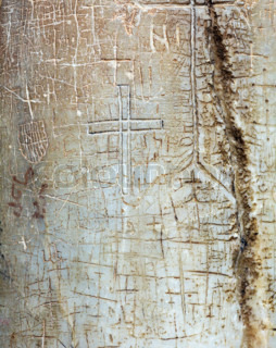 Ancient Signs on Column  of Holy Sepulcher Cathedral in Jerusalem