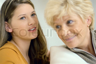 Grandmother listening to granddaughter