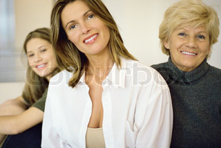 Portrait of smiling grandmother, mother, and daughter