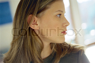 Teenage girl looking over shoulder