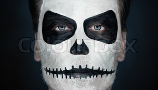 portrait of serious man with halloween skull makeup halloween or horror theme stock photo. Black Bedroom Furniture Sets. Home Design Ideas