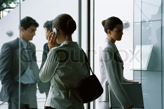Business people in lobby of office