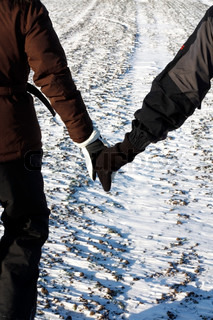 Couple in love walking hand in hand
