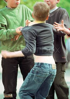 Three boys in a fight