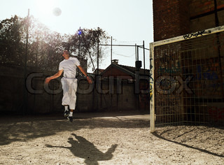 Man in air with soccer ball