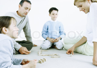 Image of 'families, on the floor, indoor'