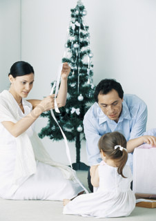 A caucasian family celebrating Christmas day