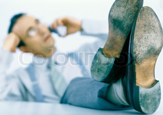 Image of 'feet, table, shoe'