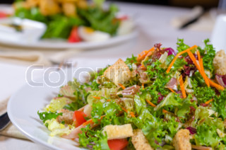Plate of healthy leafy green salad with croutons