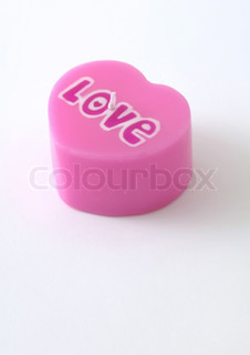 Love candle on white background