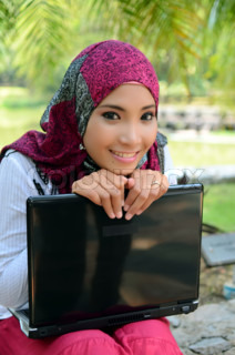 Young asian muslim woman in head scarf