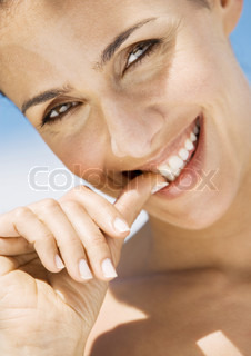 Image of 'woman, smiling, finger'