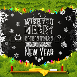 Wish you a merry christmas and happy new year message, written on the school chalkboard. Decorated with spruce tree fur.