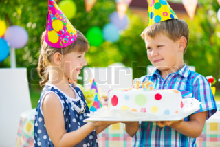 Little girl giving a birthday cake to a friend