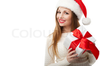 h bsche frau mit einem weihnachtsgeschenk hinter dem. Black Bedroom Furniture Sets. Home Design Ideas