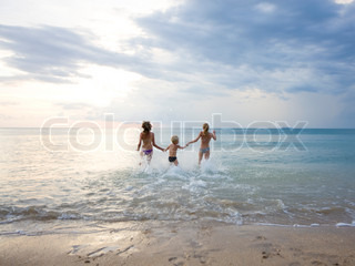 Children frolicking in the beach