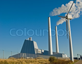 Wind mills in front of coal firedpowerplant