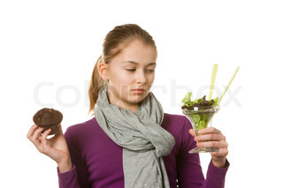 Portrait - teenage caucasian girl with a healthy and unhealthy food on her hands