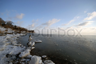 Winter landscape. Ice and snow on the beach. Little Belt winter coastline. Denmark.