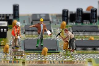 Little men repair a computer