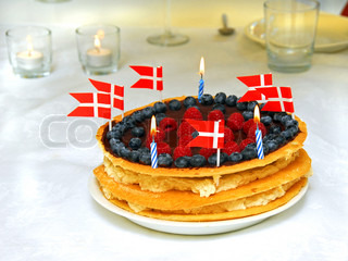 Birth cake with flags and candles