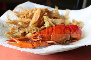 close-up macro boiled crawfish or crayfish  and fish fried of lobster farm market on the plate