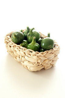 organic green and red cherry paprika in a basket