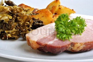 cooked organic back bacon joint with savoy cabbage