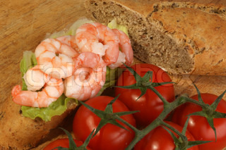 home baked bread with fresh organic prawns and tomato