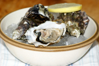 some organic oyster and lemon in a bowl