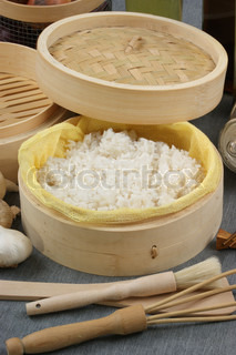 steamed organic rice in a bamboo steamer