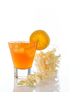 Beverage - cold orange soda on a glass and chips