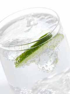 Beverage - cold fizzy drink on a glass with a sllice of lime