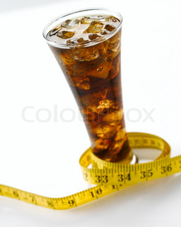 Beverage- cola on a glass and a tape measure