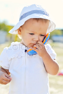 baby gir with toy phone