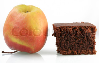 close up picture of an  apple and cake