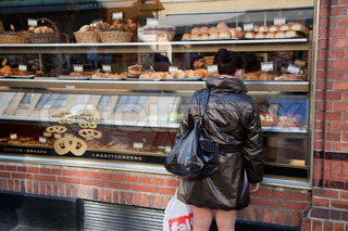 Young Girl In Front Of All The Temptations In A Bakery