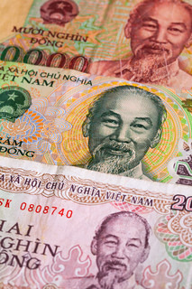 Different Vietnamese Dong banknotes on the table