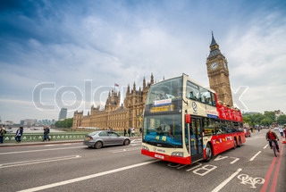 LONDON - AUG 28: Tourist bus crossing Westminster Bridge in the United Kingdom on August 28, 2013 in London. The city is visited by more than 40 million tourists annually