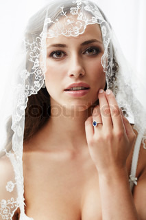 Young bride in wedding veil, studio shot