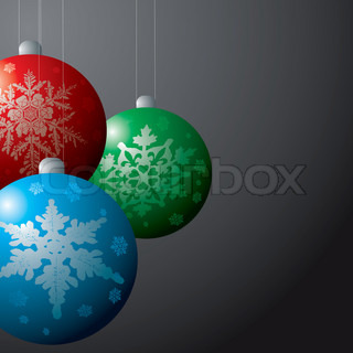 christmas decorations baubles in red green and blue on a black background
